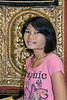 "Young Burmese shop girl posing in front of a gold tapestry, Mandalay, Myanmar<br /> <br /> I had her pose so the oval pattern on the tapestry provided a frame for her head and neck. <br /> <br /> She has thanaka paste on her face, which is made from the ground bark of the Thanaka tree (Murraya spp. ).  The paste has been used by Burmese women and children for over 2000 years. It has cosmetic, antifungal and anti-sunburn properties, and a scent somewhat similar to sandalwood. It is made by grinding the bark on a circular stone slab with some water.   In response to Donna's question (Nelli), since it leaves a residue on the skin, I imagine it is washed off at night and reapplied in the morning.<br /> <br /> Other photos from the shop, plus a couple of photos from the marble works can be seen here: <a href=""http://goo.gl/TXv9Mj"">http://goo.gl/TXv9Mj</a><br /> <br /> 7/2/14  <a href=""http://www.allenfotowild.com"">http://www.allenfotowild.com</a>"