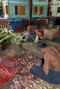 Lay workers preparing onions and squash for monk's midday meal, Mahagandayon Monastery, Amarapura, Myanmar