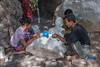 Workers polishing a marble statue of Buddha, Mandalay,Myanmar