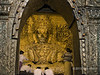 "Tons of gold! (best larger)<br /> <br /> According to legend, the Mahamuni Buddha is one of only 5 images of Buddha cast during his life-time.  It is one of Myanmar's most venerated images and a major pilgrimage site.  So much gold leaf has been applied to the Buddha that its original shape has been become somewhat amorphous except for the head, where tradition says that no gold leaf should be applied.  To date the thickness of gold applied to the image is around 15 cm, increasing the weight of the Buddha from its original 6 tons to 12 tons. Only men are allow to approach the image and apply gold leaf to it. I would have like to get better photos, but women are not allowed to approach closer than around 30 feet.<br /> <br /> In Burma gold leaf is widely applied to sacred images, but also to many other types of objects.  Some photos of this can be seen here, plus more images of the Mahamuni Buddha: <a href=""http://goo.gl/t3Gha9"">http://goo.gl/t3Gha9</a><br /> <br /> 3/2/14  <a href=""http://www.allenfotowild.com"">http://www.allenfotowild.com</a>"