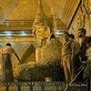 Devotees applying gold to the Mahamuni buddha, Mahamuni Temple, Mandalay, Myanmar