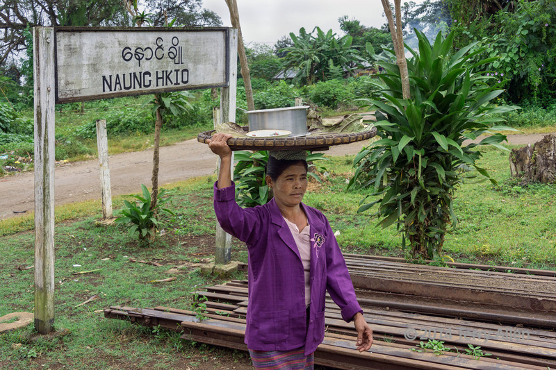 Woman selling food by the railway line at Naung Hkio, Mandalay to Pyin Oo Lwin line, Myanmar