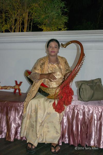 Woman playing a Burmese arched harp (Saung), Mandalay, Myanmar