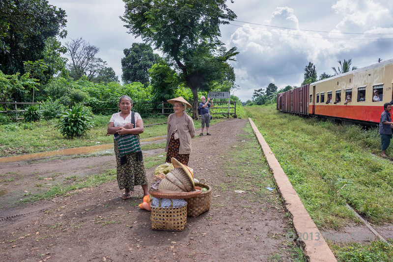 Two women with goods to sell by the Pyin Oo Lwin train, Myanmar