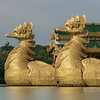 "Close-up-of-the-birds pulling the Royal Barge, Kandawgyi Park, Yangon, Burma<br /> <br /> I couldn't figure out why 'ducks' were pulling the barge, so I looked it up,   The birds are called Hamsh, traditionally geese or swans.  They are a symbol of ""purity, detachment, divine knowledge, cosmic breath (prana) and highest spiritual accomplishment"". A high level of symbolism is attached to water birds as they can walk on the earth, fly in the sky, and swim in the water."