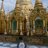 Young-man-worshiping-at-the-Schwedagon-Pagoda,-Yangon,-Burma