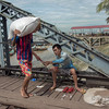 "Stevedore-handing-over-his-tally-sticks,-Irrawaddy-River-docks,-Yangon,-Burma<br /> <br /> Tally sticks are an old way of recording numbers.  Remember the words from the old Harry Belafonte song ""Come Mr Tallyman, tally me bananas"".  Well this is what it was all about."