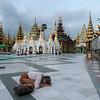 Woman-worshiping-at-the-Schwedagon-Pagoda,-Yangon,-Burma
