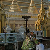 Giving-offerings-to-the-Buddha-at-a-Plenary-Position,-Schwedagon-Pagoda,-Yangon,-Burma