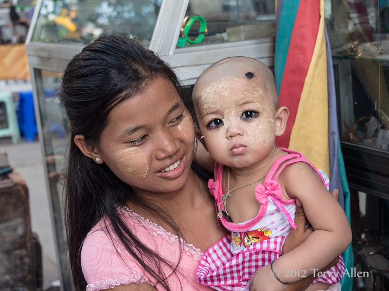 Mother and baby in marketplace, Yangon, Burma