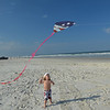 Learning how to fly a kite on Daytona beach.