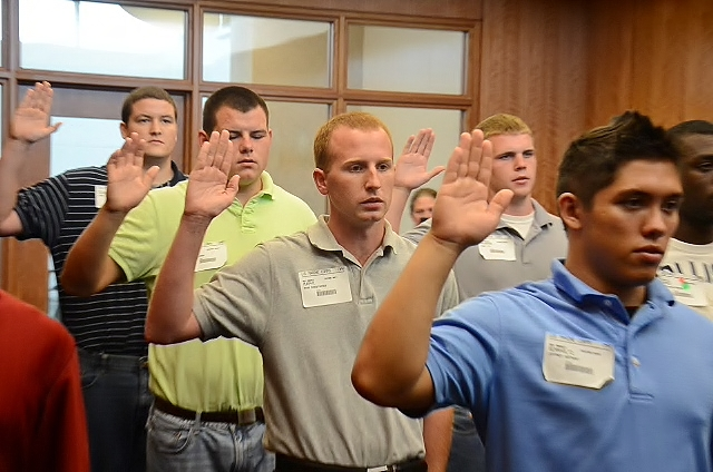 Had to put this one on today. My youngest son taking the oath of enlistment for the Marine Corps at the MEPS station in Jacksonville , Fl , yesterday. He is the one in the center of the pic.