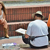 This is from our trip to Savannah this weekend , one the the street artists sketching  a girls portrait.