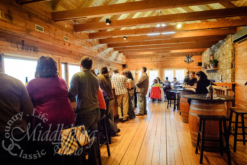 a view of the inside with the bar and tables