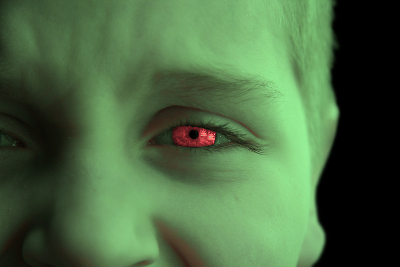 Glowing red-eyed child.
