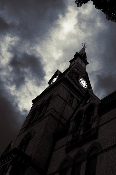 The clock tower at Hamline University looking a little evil. Minneapolis-St. Paul, Minnesota.