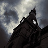 The clock tower at Hamline University looking a little evil. Minneapolis-St. Paul, Minnesota.