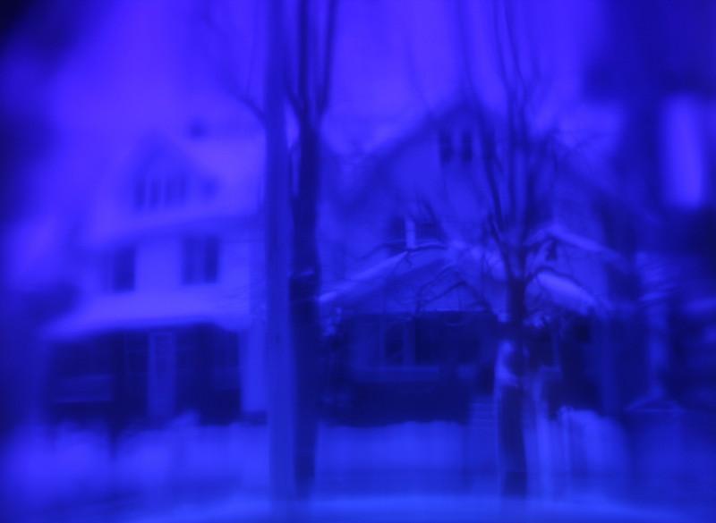 Dreamy cityscape, a neighborhood distorted through blue glass.