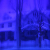 Dreamy cityscape, a neighborhood distorted through blue glass.