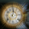 The clock face flies forward or backward. Time is on the move.