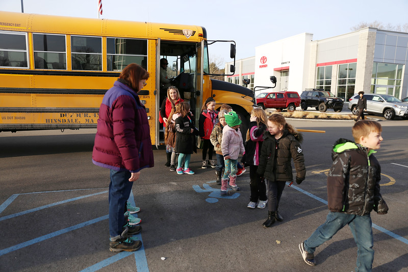 HOLLY PELCZYNSKI - BENNINGTON BANNER Molly Stark Students in the Mystery Bus after school program jump off the bus and into Bennington Honda on Thursday afternoon to recieve a tour of the dealership and the inner workings of how a car dealership works.