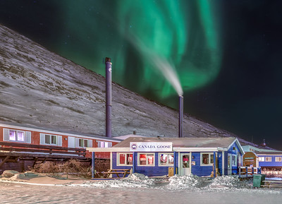 Northern Lights over a Canada Goose store in Greenland