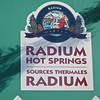 The hot springs at Radium were named after the radioactive element when an analysis of the water showed that it contained small traces of radon which is a decay product of radium.