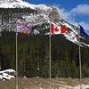 The flags of BC (left), Canada in the center and Alberta on the right.