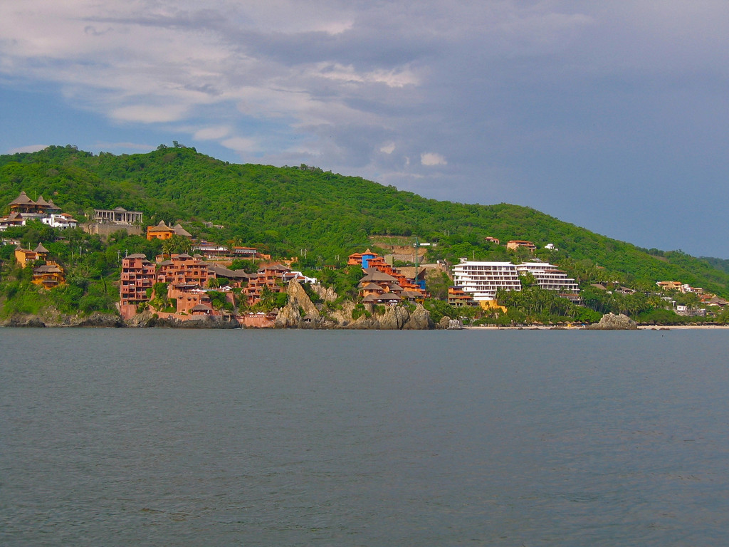 Looking at Zihuatanejo beach from the water.  The Tides is off to the far right with La Casa Que Canta in the middle and going left.