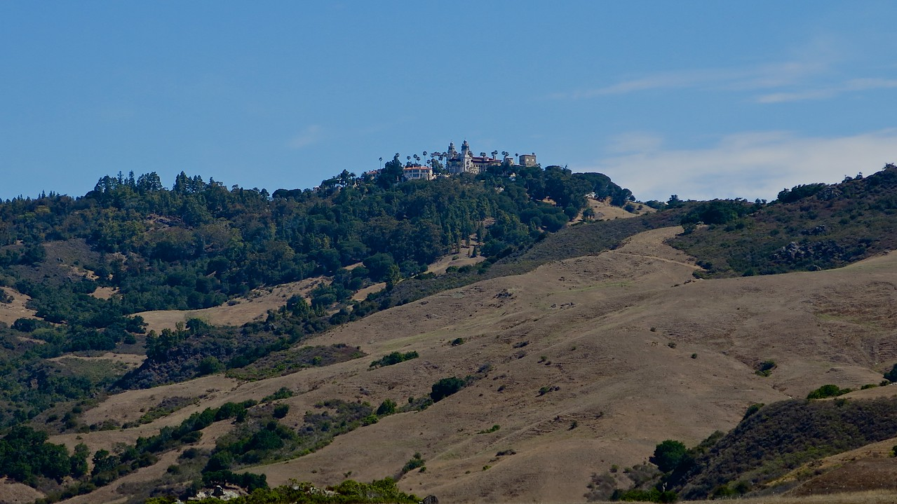 The Hearst Castle sits on top of the hill behind the Visitors Center.  The Castle is accessible only by a 5 mile bus ride via the Visitor Center.