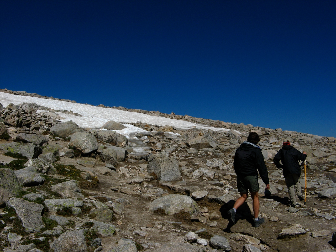 From here, the trail scales a perennial snowfield over the hitchrack and levels on the final run up to Flattop Mountain (4.3 miles in at an elevation of 12,324')