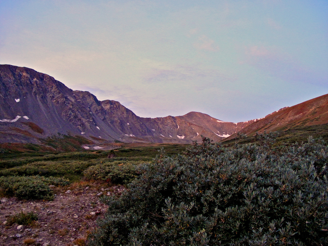 The sun is just starting to come up from behind us as we're about 20 minutes in on the trail.  Grays Peak is just to the right of the center of the picture.