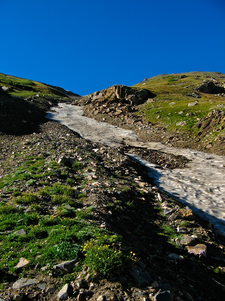 Even in late summer, there will still be snow from the previous season on parts of the trail.