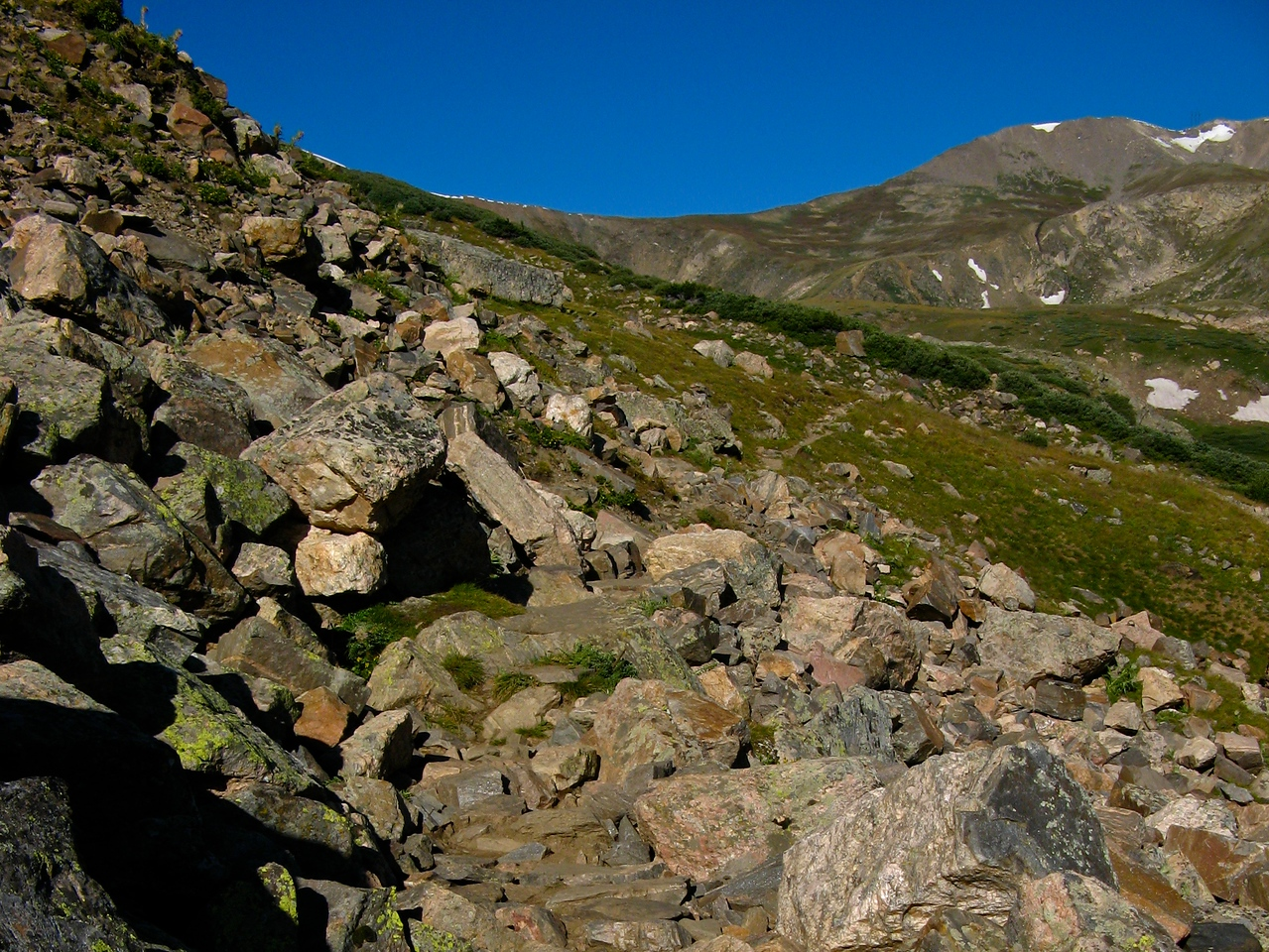 For a short distance, you'll actually have to traverse some rocks before getting back to a marked trail.