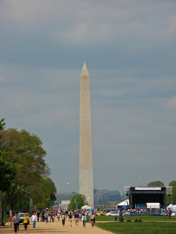 The Washington Monument is an obelisk near the west end of the National Mall in Washington, D.C., built to commemorate the first U.S. president, General George Washington. The monument, made of marble, granite, and bluestone gneiss,[1] is both the world's tallest stone structure and the world's tallest obelisk, standing 555 feet 51⁄8 inches (169.294 m).[n 1] Taller monumental columns exist, but they are neither all stone nor true obelisks