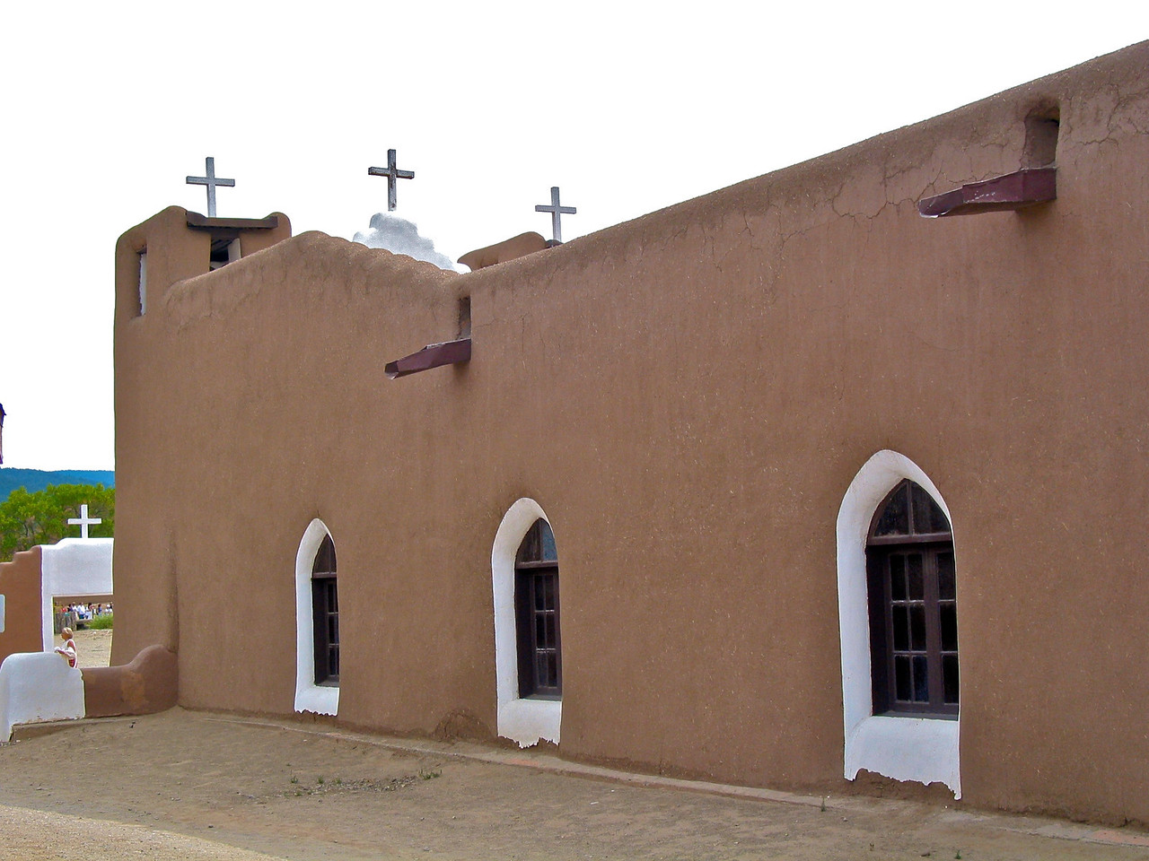 The Pueblo religion is very complex; however, there is no conflict with the Catholic church, as evidenced by the prominent presence of both church and kiva in the village.