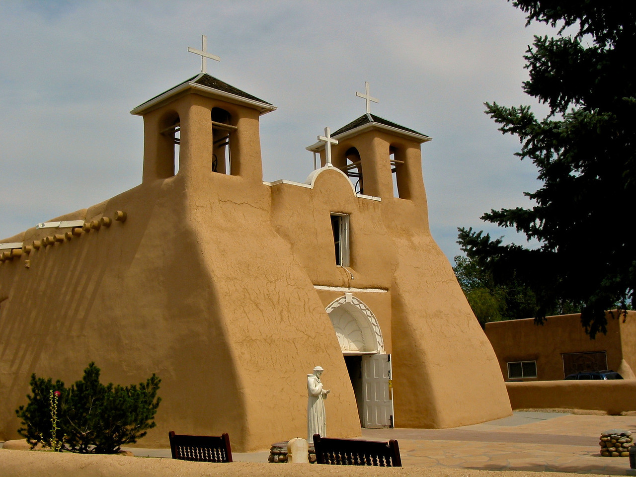 San Francisco de Asis Mission Church is a church built between 1772 and 1816. It is located on the plaza in Ranchos de Taos, itself a historic district named Ranchos de Taos Plaza, about four miles southwest of the town of Taos, New Mexico.
