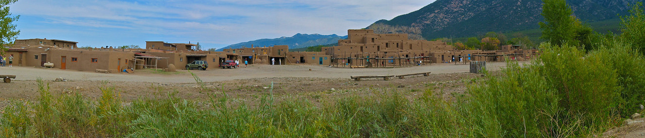 Taos Pueblo (or Pueblo de Taos) is an ancient pueblo belonging to a Taos (Northern Tiwa) speaking Native American tribe of Pueblo people. It is approximately 1000 years old and lies about 1-mile (1.6 km) north of the modern city of Taos, New Mexico, USA. . A reservation of 95,000 acres (380 km2) is attached to the pueblo, and about 1,900 people live in this area.