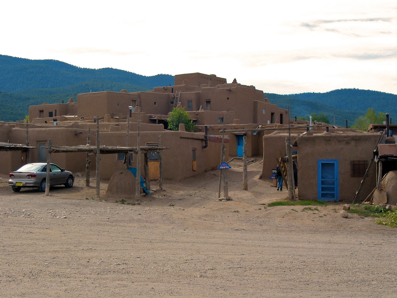 The homes in this structure usually consist of two rooms, one of which is for general living and sleeping, and the second of which is for cooking, eating, and storage. Each home is self-contained; there are no passageways between the houses. Taos Indians made little use of furniture in the past, but today they have tables, chairs, and beds. In the Pueblo, electricity, running water, and indoor plumbing are prohibited.