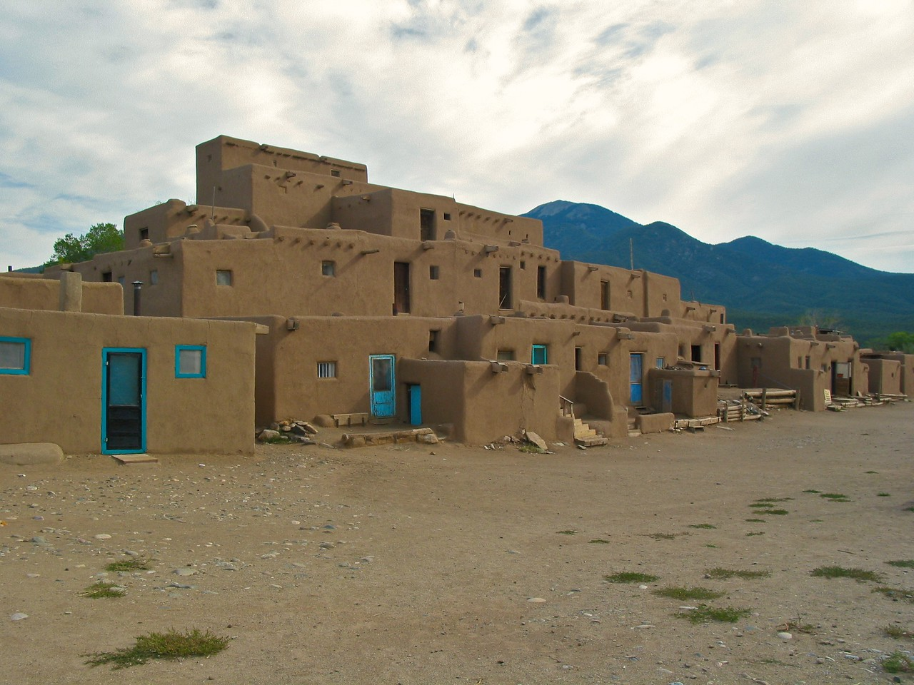 he North-Side Pueblo is said to be one of the most photographed and painted buildings in the Western Hemisphere. It is the largest multistoried Pueblo structure still existing. It is made of adobe walls that are often several feet thick. Its primary purpose was for defense. Up to as late as 1900, access to the rooms on lower floors was by ladders on the outside to the roof, and then down an inside ladder. In case of an attack, outside ladders could easily be pulled up.