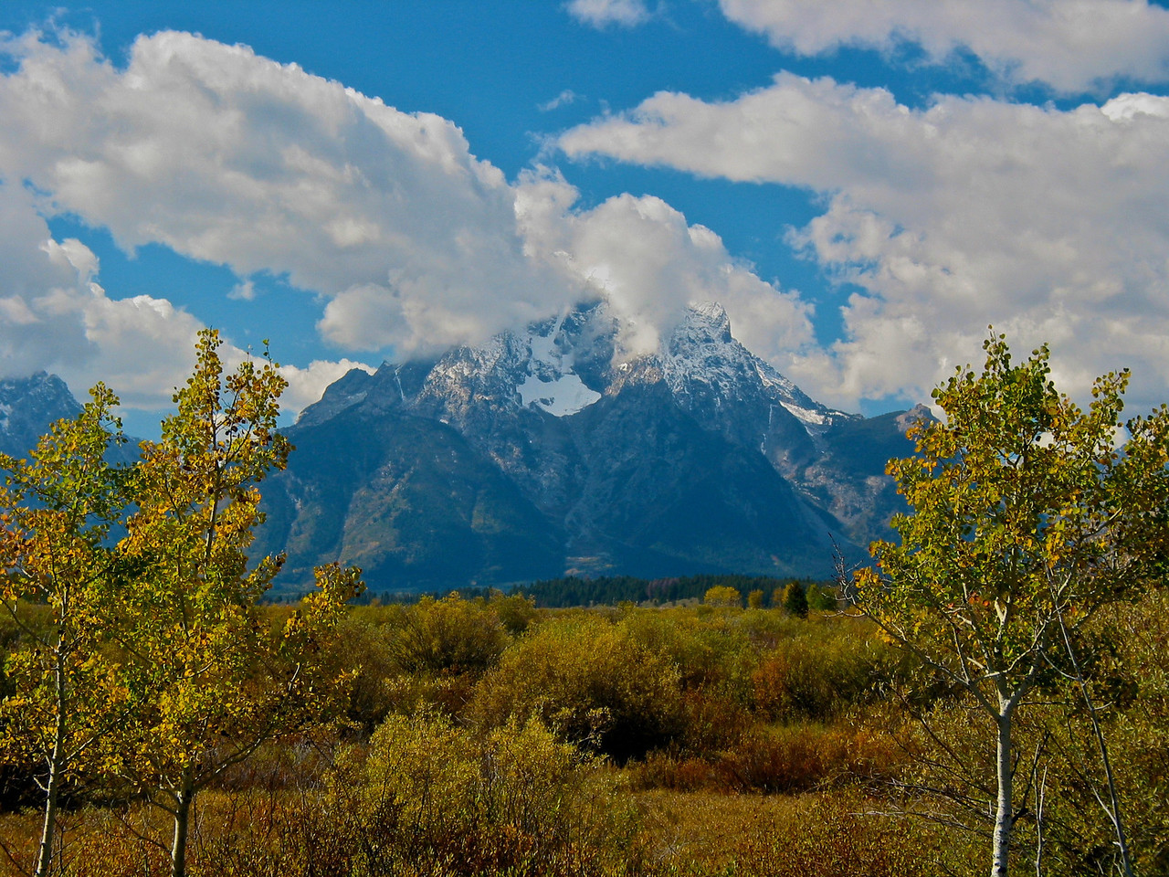 Human history of the Grand Teton region dates back at least 11,000 years, when the first nomadic hunter-gatherer Paleo-Indians would migrate into the region during warmer months in pursuit of food and supplies. In the early 19th century, the first caucasian explorers encountered the eastern Shoshone natives. Between 1810 and 1840, the region attracted various fur trading companies which vied for control of the lucrative beaver fur. Organized U.S. Government explorations to the region commenced in the 1870s as an offshoot of exploration in Yellowstone.