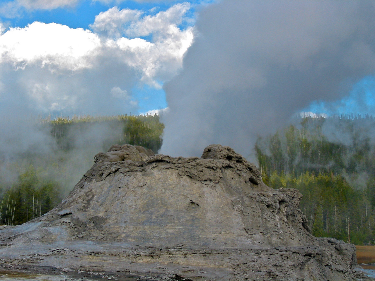 """The Yellowstone Caldera is the largest volcanic system in North America. It has been termed a """"supervolcano"""" because the caldera was formed by exceptionally large explosive eruptions. The current caldera was created by a cataclysmic eruption that occurred 640,000 years ago, which released 240 cubic miles (1,000 km³) of ash, rock and pyroclastic materials. This eruption was 1,000 times larger than the 1980 eruption of Mount St. Helens."""