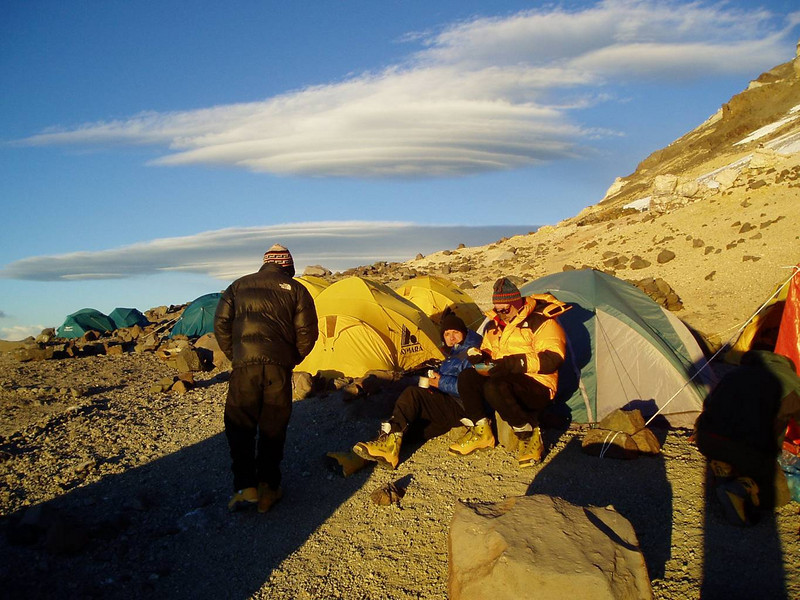 At the Nido de Condores – Camp 2.<br /> <br /> The next day we moved to Nido de Condores (5,380m / 17,600ft) – Camp 2, a large flat area exposed to the hard wind. Some rocks shielded our tents from the strong winds.  My old equipment (from the time of Sarajevo Winter Olympic Games) is still good enough.  However, for the summit, I would need something more durable.  The next day – Christmas day, we had a rest day at the Nido de Condores Camp.