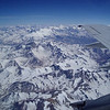 View from the plane during flight over the Andes.  Aconcagua is visible far back on the horizon.