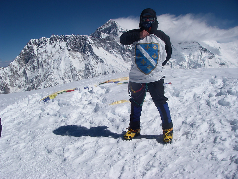 Me with Bosnian lilies on the top of Ama Dablam (22,493ft/6.856m).<br /> Behind is Mt Everest (29,035ft/8.850m)