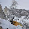 C2 (18,865ft/5.750m) – Camp was full. Sherpas built additional site for our tent.<br /> Behind Climbing Sherpa Kami and our tent is Grey Tower and four climbers.