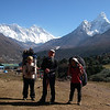 With porters in front of Tengboche monastery (12,664ft/3.860m).<br /> Behind from the left: Nuptse (25,791ft/7.861m), Mt Everest (29,035ft/8.850m), Lotse (27,940ft/8.516m), and Ama Dablam (22,493ft/6.856m)