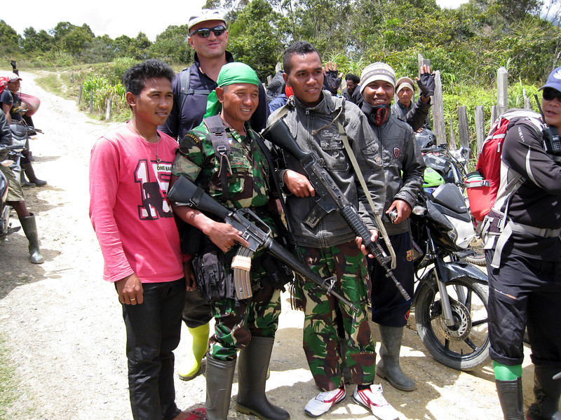 Two soldiers with powerful weapons were our protection during our move through villages.