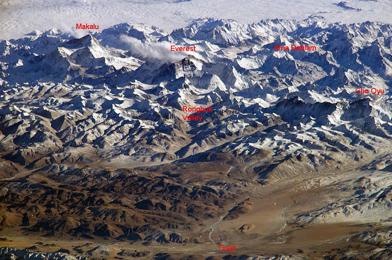 Himalaya Range – Air view from the north<br /> <br /> CHO OYU – 26,906 ft - 8.201 m<br /> - Report -<br /> <br /> Finally, after more than a year since our climb Aconcagua (22,841 ft / 6.962 m) on December 27, 2005 and hard training and preparation, we are departing to climb Cho Oyu (26,906 ft / 8.201 m) on Nepal/Tibet border.<br /> <br /> August 23, 2007:<br /> Gathering at Hotel Tibet – Kathmandu [1], Nepal [2]:<br /> Michael Hamill, leader – IMG [3] (International Mountain Guides of Seattle, WA)<br /> Eric Stevenson, leader assistant – IMG<br /> 18 climbers and 4 trekkers from 8 countries: USA, Canada, Mexico, Australia, New Zealand, UK, Romania, Bosnia.<br /> Visiting Bhaktapur [4] and Boudhanath Stupa [5]. Heavy rain. Diner at Shangri La restaurant.<br /> <br /> August 25:<br /> Flight to Lhasa [6], Tibet [7] (11,975 ft / 3.650 m)<br /> Visiting Potala Monastery [8]<br /> <br /> August 27:<br /> Drive to Shigatse [9], Tibet (12,598 ft / 3.840 m)<br /> Visiting Tashilhunpo Monastery [10] and the biggest statue of a sitting Buddha: 26.2 meters (86 ft) high.<br /> First acclimatization [11] hike to 14,180 ft or 4.322 m on Drolmari Mountain with 1,339 ft or 408 m elevation gain. Fair weather.<br /> <br /> August 29:<br /> Drive to Tingri [12], Tibet (12,586 ft / 4.380 m)<br /> Second acclimatization [11] hike to 15,502 ft or 4.725 m with 1,102 ft or 336 m elevation gain. A lot of rain.<br /> <br /> August 31:<br /> Drive to Base Camp (BC) (16,001 ft / 4.877 m). Trip through Tibet to this point organized by CTMA [13] (China Tibet Mountaineering Association). One person per tent.<br /> In order to have some reasonable sunrise and sunset times, we change the time back to Nepal time zone, i.e. 2 1/4 hours back. Otherwise the sun would always rise at half past eight. 7 members of Singapore Team arrive.<br /> Third acclimatization [11] hike to 17,224 or 5.250 m with 1,224 ft or 373 m elevation gain. Fair weather. <br /> BC is a tent city of transients. Expeditions and ya