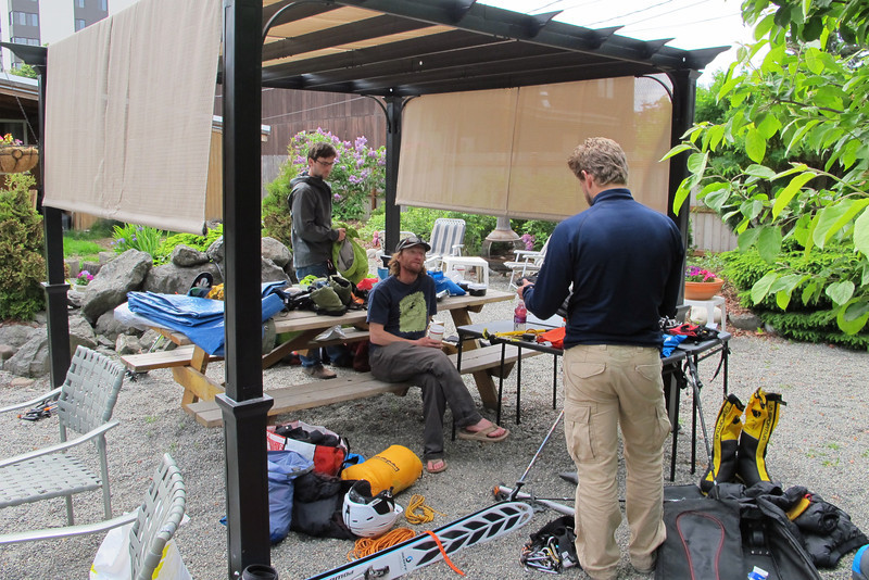 June 22nd - Anchorage, AK - Earth B&B - Checking our equipment...<br /> From left: John W, Durny (sitting), and Tim.